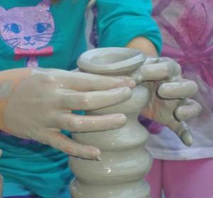 child-on-potters-wheel